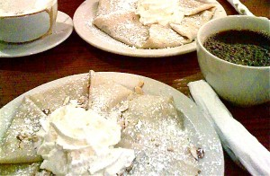 crepes with nutela, toasted almonds, powdered sugar, and whipped cream.